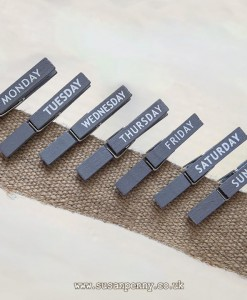 grey painted clothes pegs